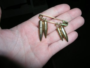 TFP member holds the four bullets that nearly took the life of Colonel Ripley.