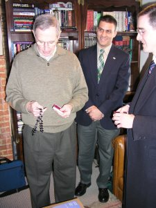 "Members of the American Society for the Defense of Tradition Family and Property (TFP) present Colonel John Ripley with a rosary. ""This rosary will not collect dust,"" said Colonel Ripley in response to this gift."