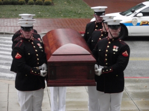 Marine Corps body bearers carry the coffin of Moline Ripley up the front steps of the Naval Academy Chapel in Annapolis Maryland.