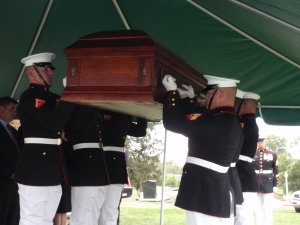 "Marine Corps body bearers raising the coffin of Moline Ripley before the final blessings. ""Vaunted on high"" as Col. John Ripley would have wanted it."
